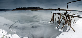 Fishing jetty. On a frozen river Stock Photos