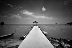 Fishing jetty in black and white at Port Dickson Stock Photo