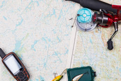 Fishing journey with tackles and gps navigator Royalty Free Stock Photos