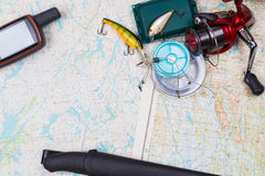 Fishing journey with tackles and gps navigator Stock Photo