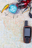 Fishing journey with tackles and gps navigator Royalty Free Stock Image