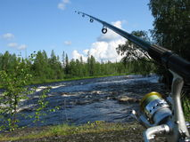 Fishing in Kareliya, Russia. View of fishin on river by green Kareliyan wood, Russia Royalty Free Stock Images