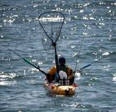 Fishing from a Kayak. Near Santa Cruz, Pacific Ocean Royalty Free Stock Images