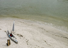 Fishing kayak o the beach 3. Photo image of a fishing kayak on a beach in Florida Royalty Free Stock Photography