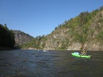 Fishing and kayaking, Irkut river, Sayan mountains, Siberia, Russia, Siberian landscapes Royalty Free Stock Images