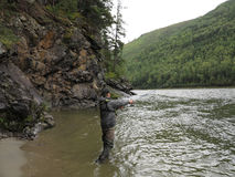 Fishing and kayaking, Irkut river, Sayan mountains, Siberia, Russia, Siberian landscapes Stock Images