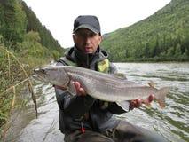 Fishing and kayaking, Irkut river, Sayan mountains, Siberia, Russia, Siberian landscapes Royalty Free Stock Photo
