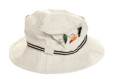 Fishing  khaki hat with dry flies. Isolated fishing khaki hat with dry flies on white background Royalty Free Stock Image