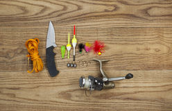Fishing Kit with assorted equipment on aged wood Royalty Free Stock Photos