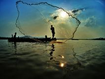 Fishing on Lak lake on the sunset time. Daily life in Jung village along the Lak lake, Daklak prov., Viet Nam Royalty Free Stock Images