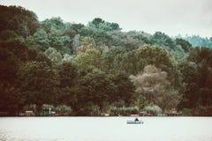 Fishing on lake. Angler on the boat fishing on the lake royalty free stock photos