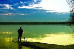 Fishing in a lake Royalty Free Stock Photography