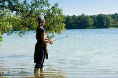 Fishing at the lake Royalty Free Stock Images