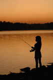 Fishing by the lake Royalty Free Stock Photo
