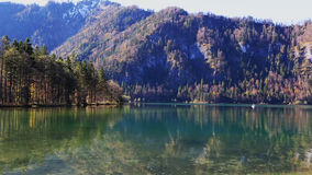 Fishing on the lake in the Alps stock footage