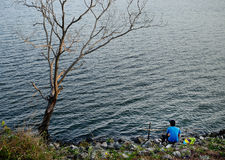 Fishing at lake Royalty Free Stock Image