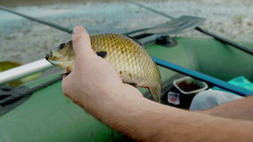 Fishing on the lake. Fish rod. crucian, small boat fishing.Cinema camera footage stock footage