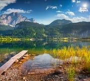 Fishing on the lake Grundlsee. Royalty Free Stock Image