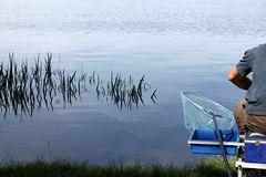 Fishing on the lake. Man fishing on the lake stock photo