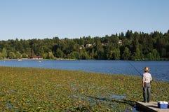 Fishing on lake royalty free stock photos