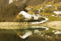 Fishing in the lake. With the reflection of trees and snow Stock Photography
