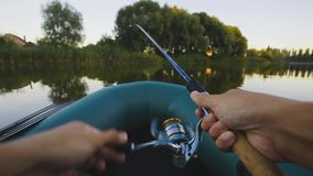 Fishing on a lake from rubber boat. first-person view