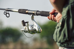 Fishing on the lake. Spinning reel. And background of lake Stock Photo