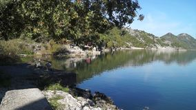 Fishing on lake in sunny day. In Montenegro fishing boats stock video footage