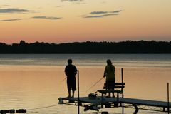 Fishing on the Lake at Sunset Royalty Free Stock Photos
