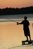 Fishing on the Lake at Sunset Stock Images