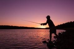 Fishing a Lake at Sunset Royalty Free Stock Image