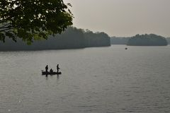 Fishing on a lake stock images