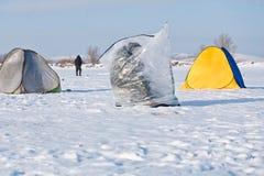 Fishing in winter lake Stock Photo