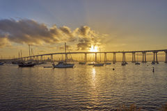 Fishing and leisure boats under a beautiful sunrise and the Coronado Bridge, San Diego California Royalty Free Stock Photography