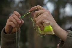 Fishing line. Detail of a Man Preparing fishing line Stock Photos