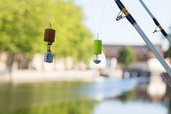 Fishing Line and Floats Against Canal background Royalty Free Stock Photos