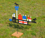 The fishing Lithuanian weather vane costs on a grass.  Royalty Free Stock Photography