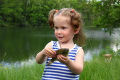 Fishing - littlle girl with catching fish Royalty Free Stock Photo