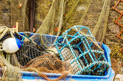 fishing lobster baskets and crabs layered on it, fishing industry, fishing lines, boats in the harbor, ocean stock photography