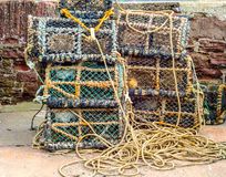 Fishing lobster baskets and crabs layered on top of each other, stock images