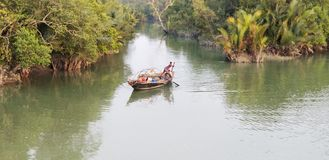 Fishing on the local boat. World largest mangrove forest Stock Photo