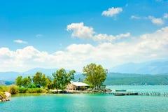 Fishing lodge on shores of scenic Lake. Stock Photo