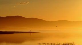 Fishing. Lone fisherman seen fishing on leisure isle, Knysna in South Africa Stock Images