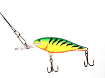 Fishing lure. Yellow/Green fishing lure isolated on white stock images