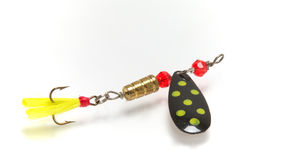 Fishing lure. A multi colored fishing lure with treble hook Stock Photo