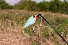 Fishing lure attached to a line Stock Photo