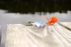 Fishing lure  blue,green and orange. Fishing lure with one hook, green,blue, orange and a red fly Stock Photo