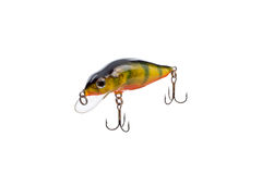 Fishing lure for catching predator isolated on white background. Hard bait lure for catching predatory fish equipped with triple hooks isolated on white Royalty Free Stock Image