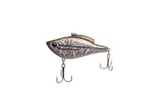 Fishing lure for catching predator isolated on white background. Hard bait lure for catching predatory fish equipped with triple hooks isolated on white Royalty Free Stock Photography