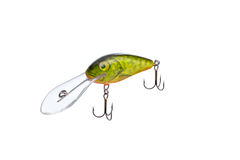 Fishing lure for catching predator isolated on white background. Hard bait lure for catching predatory fish equipped with triple hooks isolated on white Royalty Free Stock Photo